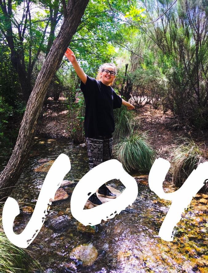 Joy walking through riparian preserve in Gilbert, AZ